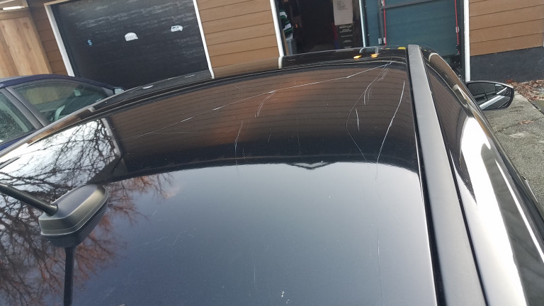 Client's wife scratch car with a hockey stick while removing snow from the roof of this Ford Focus